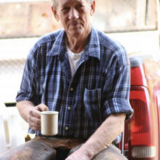 Photo I took of him sitting on his tailgate taking a coffee break. - Christi Darby Faccinto