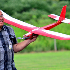 Chuck is happy after putting in another long flight on his glider. - Todd Davis