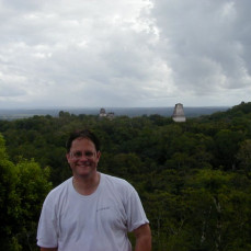 Jim Esler on top of Temple 4 in the Tikal ruins - Wayne Monson
