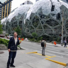 Downtown Seattle in front of the Amazon Sphere.  And his free banana  - Delouah Todd