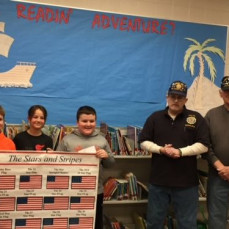Randy presenting Flag Essay awards to our 5th graders from a few years ago.   - Brian Summy