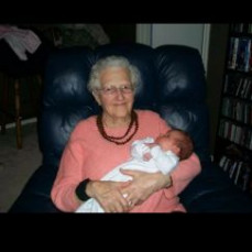 Holding her 1st great grandchild - Sarah Calmes